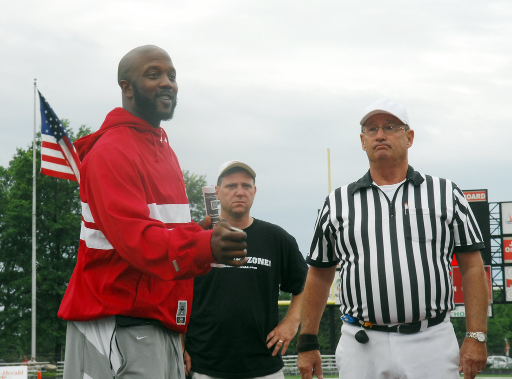 . News-Herald file Tony Fisher tosses the coin before the start of Saturday\'s News-Herald Senior Bowl.