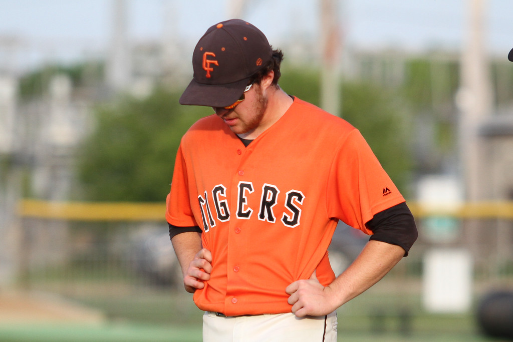 . Michael Johnson - News-Herald Erik Wilson of Chagrin Falls bows his head after losing to Poland 13-3 in the Division II Hudson Regional Final on May 27.
