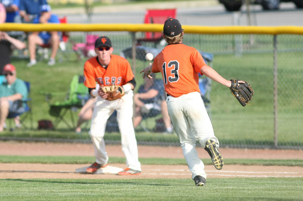 . Michael Johnson - News-Herald Chagrin Falls\' Pitcher, Jack Amendola, flips the ball to first baseman, Brennan Izzo, for an out during the Division 2 Hudson Regional Final on May 27, 2016.  Poland defeated Chagrin Falls 13-3.