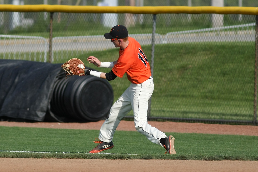 . Michael Johnson - News-Herald Brennan Izzo of Chagrin Falls catches a foul ball during the Division 2 Hudson Regional Final on May 27, 2016.  Poland defeated Chagrin Falls 13-3.