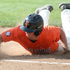 Michael Johnson - News-Herald<br /> Tyler Zaluski of Chagrin Falls slides head first into first base during the Division 2 Hudson Regional Final on May 27, 2016.  Poland defeated Chagrin Falls 13-3.