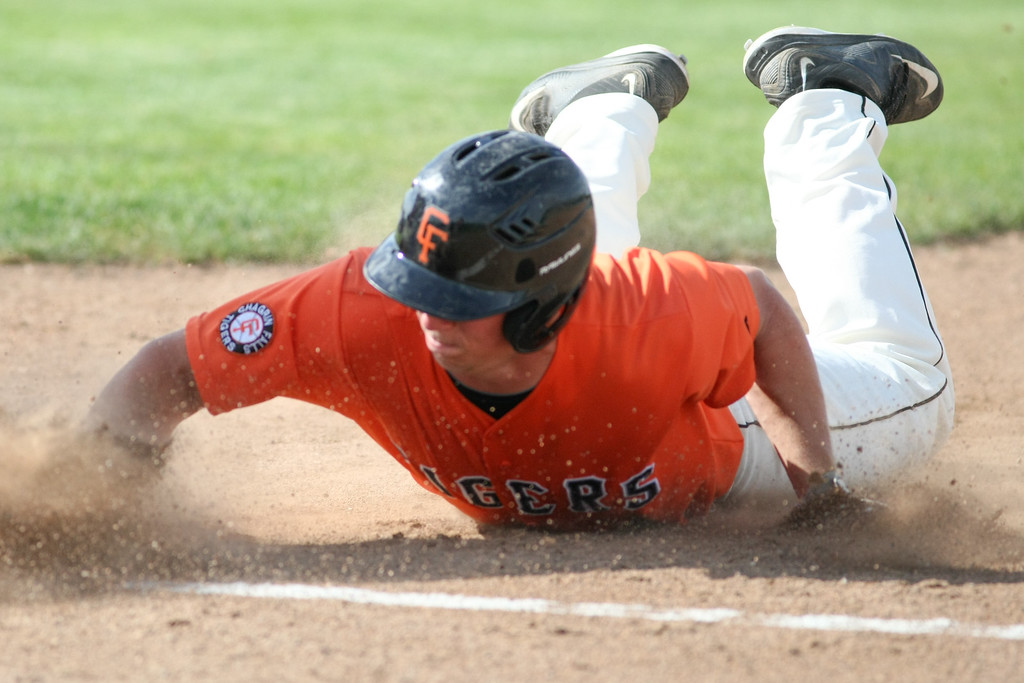. Michael Johnson - News-Herald Tyler Zaluski of Chagrin Falls slides head first into first base during the Division 2 Hudson Regional Final on May 27, 2016.  Poland defeated Chagrin Falls 13-3.