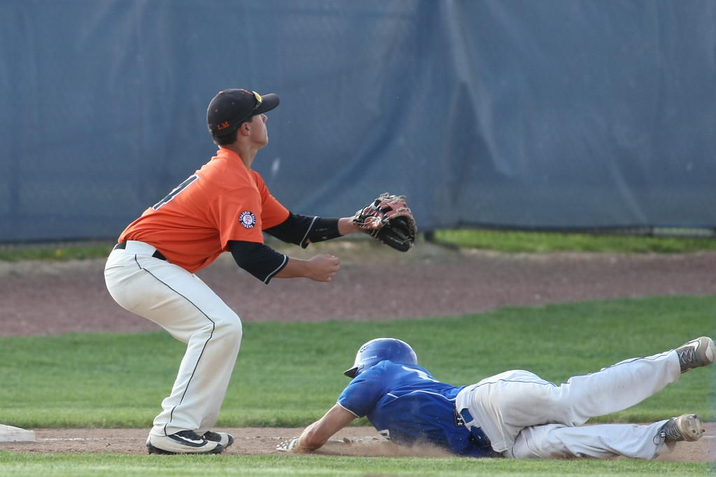 . Michael Johnson - News-Herald Poland\'s Don Drummond (right) slides into third base to beat Chagrin Falls\' Colin Kennedy during the Division 2 Hudson Regional Final on May 27, 2016.  Poland defeated Chagrin Falls 13-3.