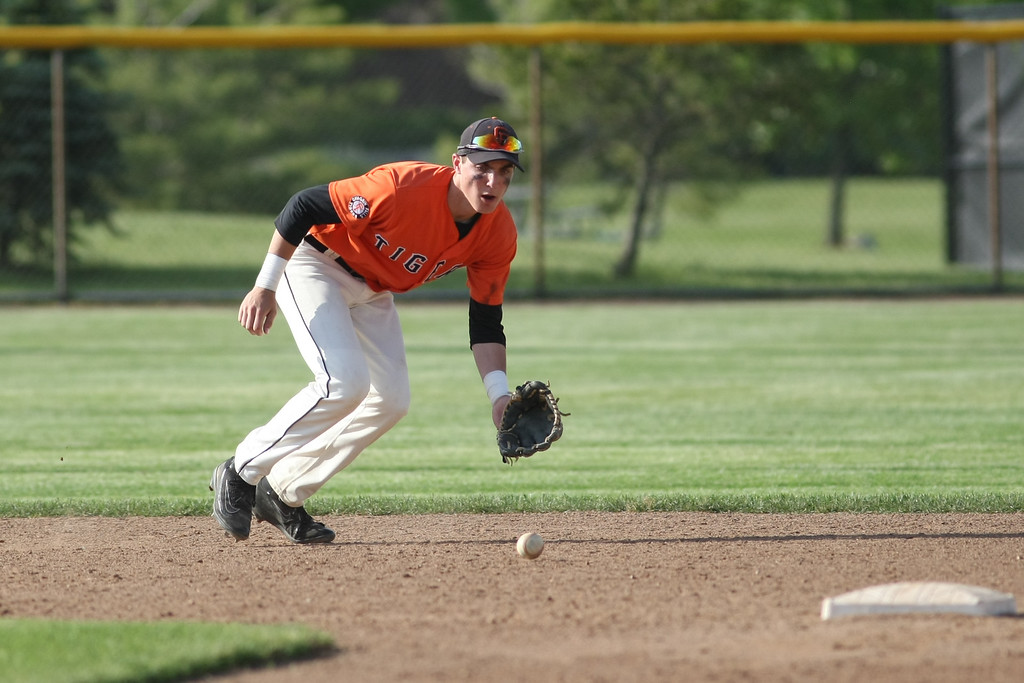 . Michael Johnson - News-Herald Chagrin Falls shortstop Adam Bencke fields the ball during the Division II Hudson Regional Final on May 27.  Poland defeated Chagrin Falls 13-3.