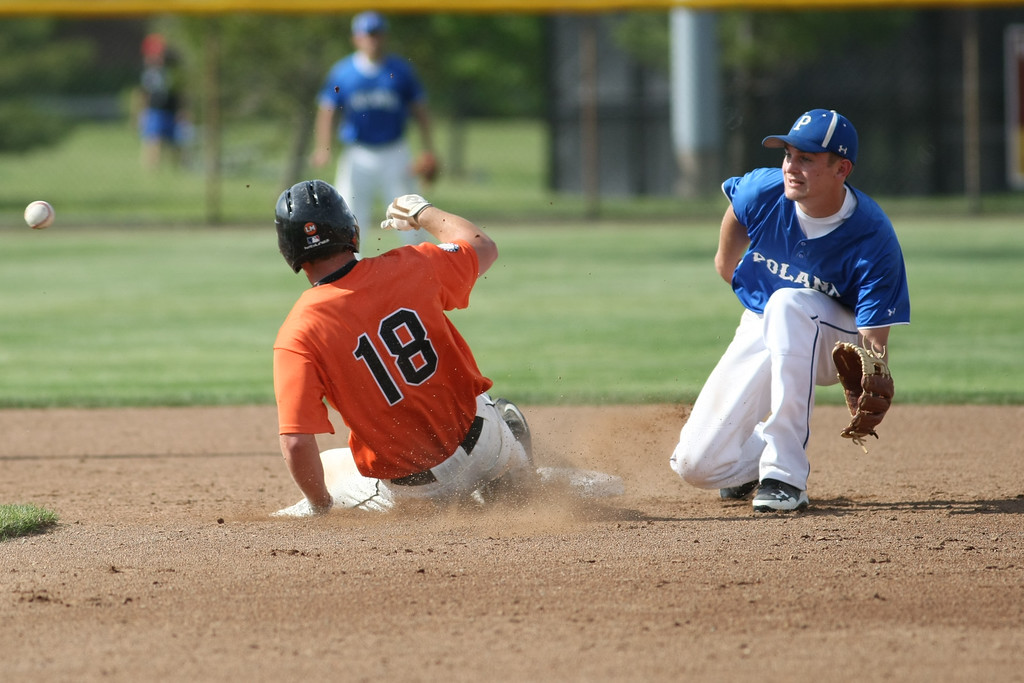 . Michael Johnson - News-Herald Chagrin Falls\' Tyler Zaluski (left) slides into second base to avoid the tag from Poland\'s Jared Burkert (right) during the Division 2 Hudson Regional Final on May 27, 2016.  Poland defeated Chagrin Falls 13-3.