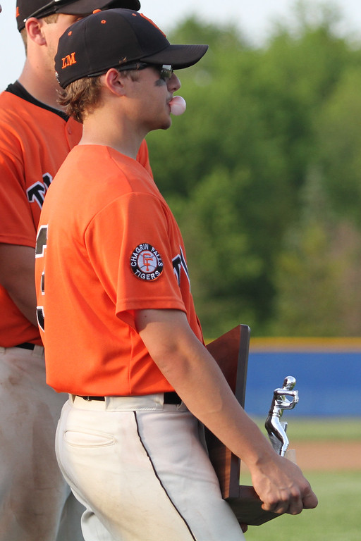 . Michael Johnson - News-Herald Chagrin Falls\' Justin Bargar watches as Poland celebrates their Division 2 Hudson Regional Final Win on May 27, 2016.  Poland defeated Chagrin Falls 13-3.