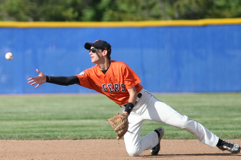 . Michael Johnson - News-Herald Jeff Lewinski of Chagrin Falls tosses the ball to second base to initiate a double play against Poland during the Division 2 Hudson Regional Final on May 27, 2016.  Poland defeated Chagrin Falls 13-3.