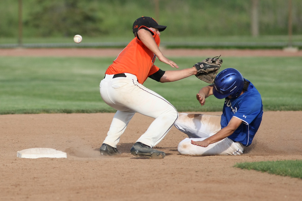 . Michael Johnson - News-Herald Poland\'s Don Drummond (right) avoids a tag from Chagrin Falls\' Cole Newbauer during the Division 2 Hudson Regional Final on May 27, 2016.  Poland defeated Chagrin Falls 13-3.