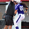 Jon Behm - The Morning Journal<br /> Keystone senior Summer Constable jump to give coach Jim Piazza a high five while rounding third after hitting a home run in the bottom of the first inning against Maumee during the Bucyrus Region final on May 29.