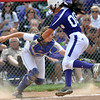 Jon Behm - The Morning Journal<br /> Keystone senior Summer Constable (00) tries to dodge Maumee catcher Kayla Wulf in the bottom of the third inning during the Bucyrus Region final on May 29. Constable was called out.