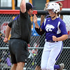 Jon Behm - The Morning Journal<br /> Keystone junior Lauren Shaw gets a high-five from coach Jim Piazza while rounding third after her home run in the bottom of the second inning against Maumee during the Bucyrus Region final on May 29.