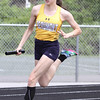 Michael Johnson - The News-Herald<br /> Beaumont's Caitlyn Lux runs in the opening leg of the girls 4x200 meter relays during the Division 2 Track and Field Regional Finals at Austintown-Fitch High School on May 28, 2016.