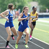 Michael Johnson - The News-Herald<br />  Izzy Greene of Gilmour runs in the final leg of the Girls 4x400 meter relays during the Division 2 Track and Field Regional Finals at Austintown-Fitch High School on May 28, 2016.