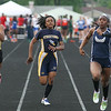 Michael Johnson - The News-Herald<br /> Beachwood's Mia Knight (left) races against Streetsboro's Savannah Netels (center) and West Geauga's Brittni Mason (right) in the 100 meter dash during the Division 2 Track and Field Regional Finals at Austintown-Fitch High School on May 28, 2016.