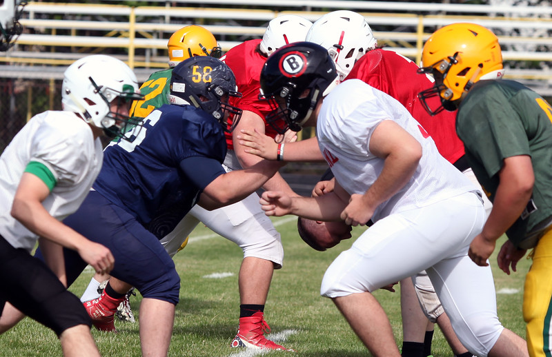 Randy Meyers - The Morning Journal<br /> North Ridgeville's Alex Carpenter and Brookside's Duke Kovacs work on punt coverage during the Stripes practice in preparation for the Lorain County Senior All-Star game on June 6. The offensive line is what the team believes gives the Stripes an advantage.