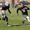 Randy Meyers - The Morning Journal<br /> Columbia's Jared Heidecker closes in on a Vermilion football alumni member during the Stars practice in preparation for the Lorain County Senior All-Star game on June 6.