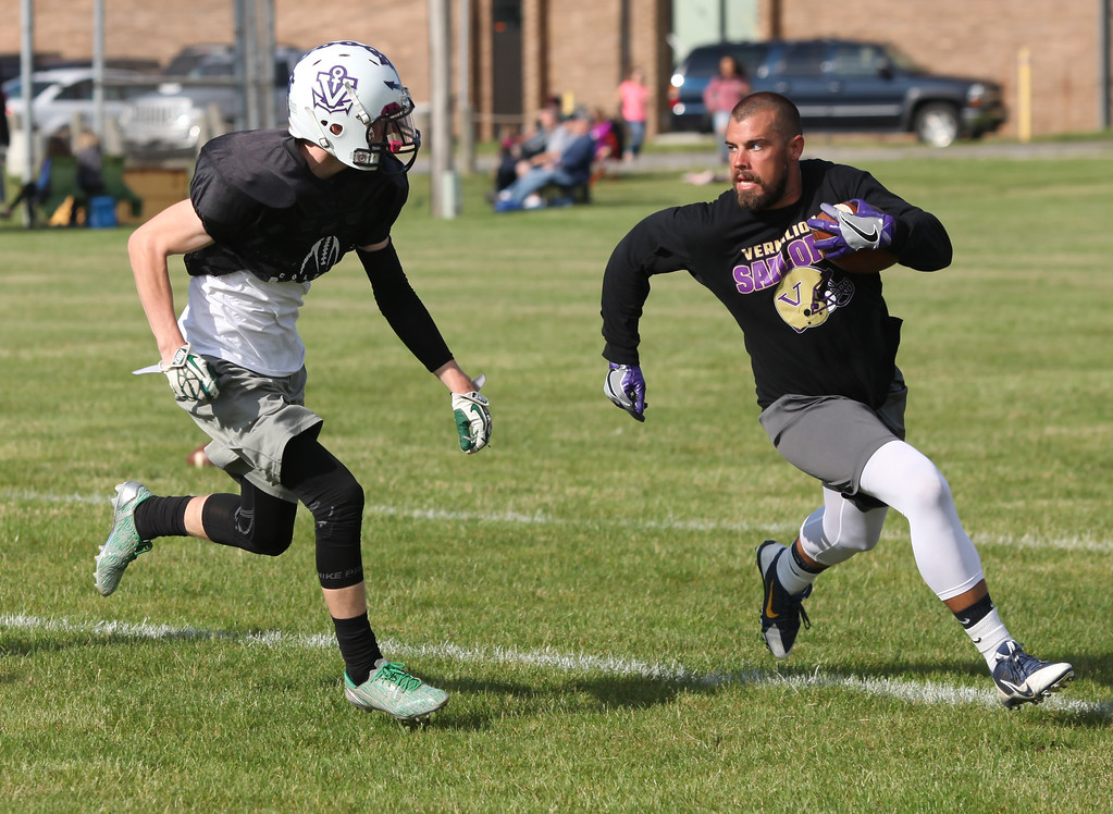 . Randy Meyers - The Morning Journal Columbia\'s Jared Heidecker closes in on a Vermilion football alumni member during the Stars practice in preparation for the Lorain County Senior All-Star game on June 6.