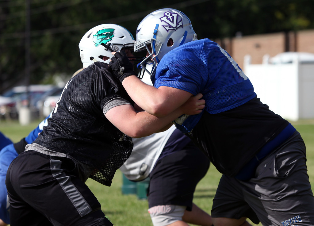 . Randy Meyers - The Morning Journal Columbia\'s Garhett Wheatley, left, battles Aaron Botos of Midview during the Stars practice in preparation for the Lorain County Senior All-Star game on June 6.