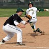 Randy Meyers - The Morning Journal<br> During his junior year, Westlake's Michael Parfejewiec tries to tag out Evan Shawver of Amherst at third base on May 12, 2017.