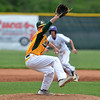 Scott Mahoney - The Morning Journal<br> During his freshman year, Amherst's Evan Shawver, foreground, delivers a pitch as Avon's Dom Massa leads off from second base during the Division I district semifinal on May 19, 2015 at the Pipe Yard.