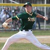 Randy Meyers - The Morning Journal<br> During his senior year, Evan Shawver of Amherst delivers a pitch against Avon on April 12, 2018.