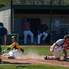 Eric Bonzar - The Morning Journal<br> During his sophomore year, Amherst's Evan Shawver slides across home for a run against Mentor on May 6, 2016.