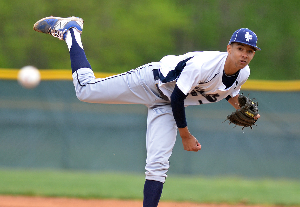 . Morning Journal file<br> Lorain pitcher Xavier Moore delivers a pitch in a sectional semifinal against Westlake on May 12 at the Pipe Yard.