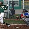 Randy Meyers - The Morning Journal<br> Xavier Moore of Amherst lines a base hit against Midview. The Comets would win the  game by a 12-1 score.