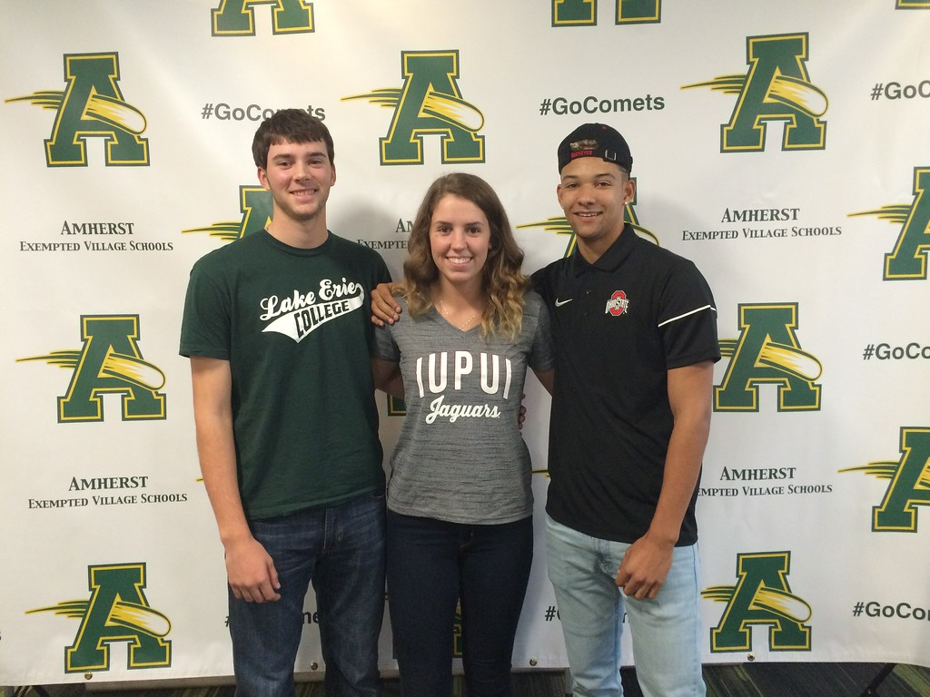 . Morning Journal File<br> From left, Brian D\'Andrea, Sydney Roule, and Xavier Moore pose at Amherst High School following a National Signing Day event.