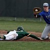 Randy Meyers - The Morning Journal<br> Midview first baseman Owen Hawke  looks the ball in as Xavier Moore of Amherst dives back to first on April 4.