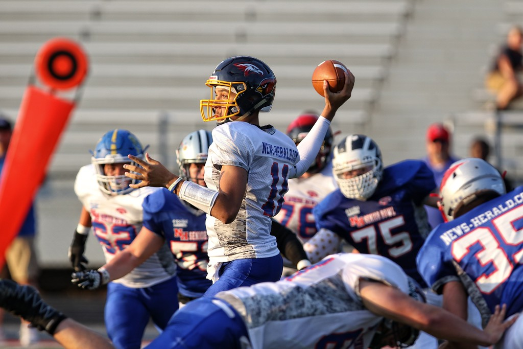 . Tim Phillis- The News-Herald QB Noah Mitchell stands in pocket.