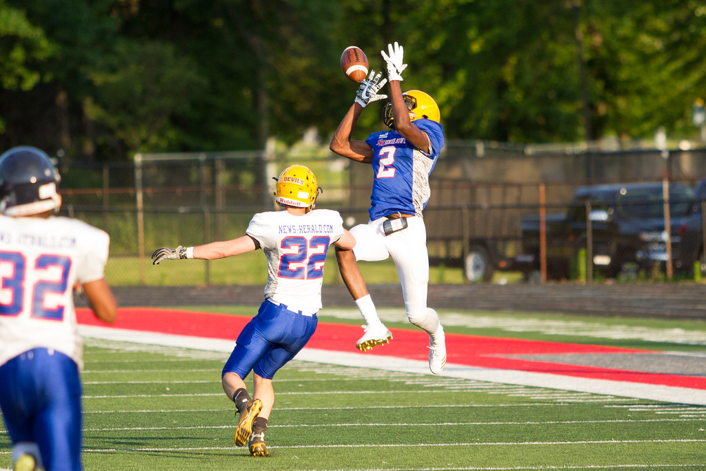 . Barry Booher - The News-Herald Beachwood\'s Mark Ferrell Jr.  can\'t make the catch behind Wickliffe\'s Rob Johnson.