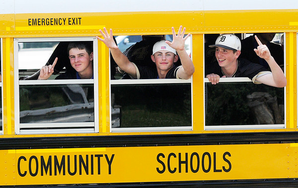 Don Knight | The Herald Bulletin<br /> The Daleville Broncos parade through town after capturing their second state baseball title in three years on Saturday.