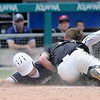 Don Knight | The Herald Bulletin<br /> Ethan Pittsford tags Ben Ewer out at home plate in the bottom of the eighth inning at Victory Field on Saturday.