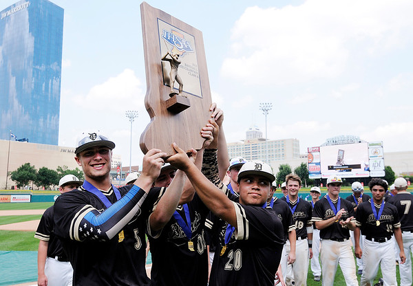 Don Knight | The Herald Bulletin<br /> From left, Ryan Hale, Evan Baker and Garrett Boles hoist Daleville's state championship trophy after the Broncos beat University 4-2 in nine innings at Victory Field on Saturday.