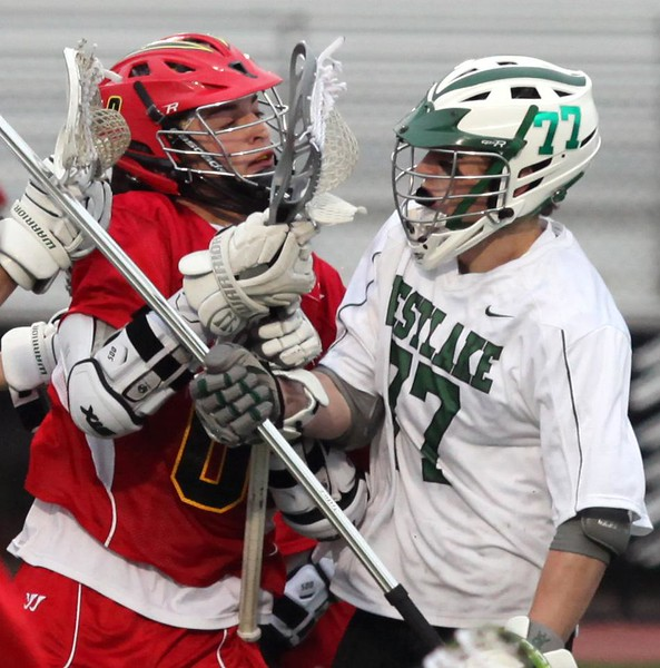 Randy Meyers - The Morning Journal<br> Westlake's Trey Bialowas and Brecksville-Broadview Heights' Paxton Speer go face to face for ball  possesssion during the second quarter on May 5.