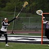 Randy Meyers - The Morning Journal<br> St. Joseph goalie Danielle Smith clears the ball from her goal while under pressure from Ija Atanaskovic of Westlake on May 4.