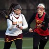 Randy Meyers - The Morning Journal<br> Avon Lake's Marina Wilson looks to pass and is defended by Rachael Gordon of Brecksville-Broadview Heights during the first half on April 7.