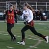 Randy Meyers - The Morning Journal<br> Taylor Baiers of Avon Lake runs past Elaina Walcutt of Brecksville-Broadview Heights during the first half on April 7.