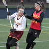 Randy Meyers - The Morning Journal<br> Liv MacDonald of Avon Lake runs the ball past Elaina Walcutt of Brecksville-Broadview Hteights near the sideline during the first half on April 7.