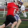 Randy Meyers - The Morning Journal<br> Lutheran West's John Spooner attepts to run past the defense by Max Smith of Avon during the second quarter on March 21.