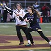 Randy Meyers - The Morning Journal<br> Megan Barnes of Avon Lake contests a pass to Grace Hyppa of Olmsted Falls near midfield during the first half on March 23.