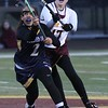 Randy Meyers - The Morning Journal<br> Avon Lake's Kerry Gray reaches over May Alhashash for control of the ball near midfield during the first half on March 23.