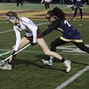 Randy Meyers - The Morning Journal<br> Megan Barnes of Avon Lake controls the ball in front of May Alhashash of Olmsted Falls during the first half on March 23.
