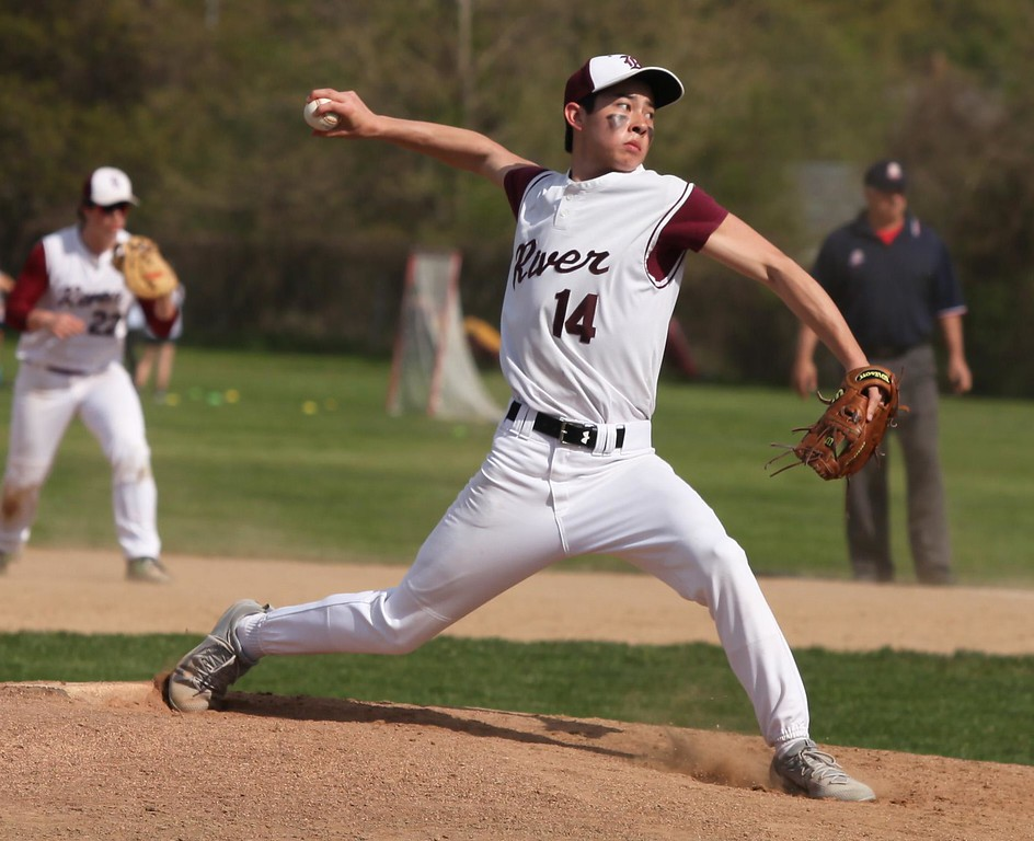 . Randy Meyers - The Morning Journal<br> Rocky River starting pitcher Eric Kois delivers a pitch against Lorain during the second inning on April 26.