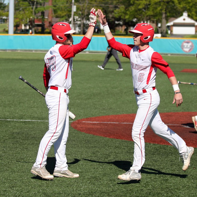 . Randy Meyers - The Morning Journal<br> Austin Urban of Firelands is congratulated by teammate Clayton Lucki after scoring against Buckeye on May 15.