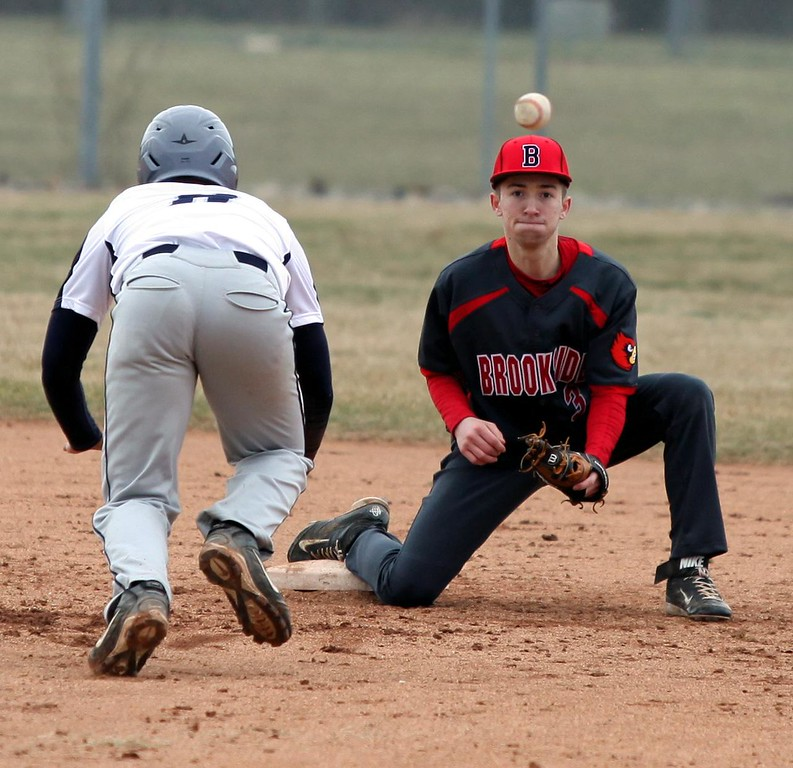 . Randy Meyers - The Morning Journal<br> Brookside shortstop Christian Fields watches the throw coming towards him during a steal attempt at second base by Tre\'von Morgan of Lorain on March 25.