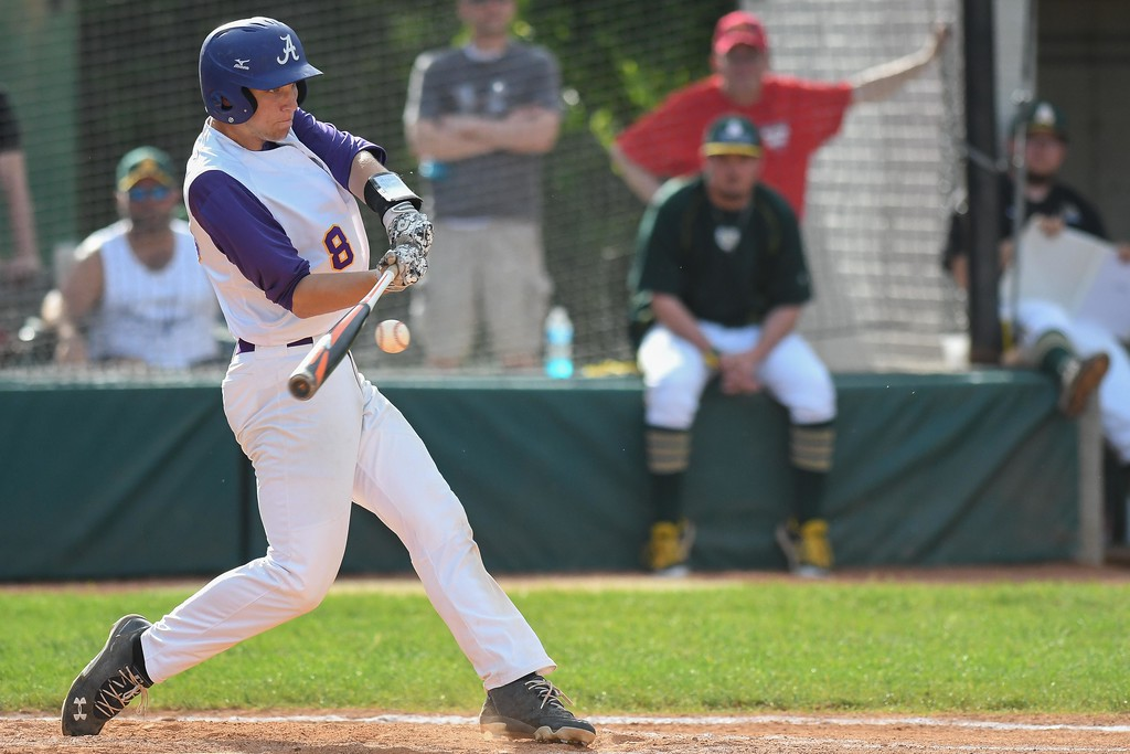 . Eric Bonzar � The Morning Journal<br> Avon\'s Tommy Kocar drives in a run in the top of the fourth inning against Amherst on May 18.