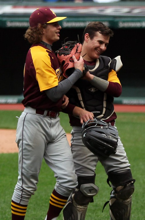 . Randy Meyers - The Morning Journal<br> Avon Lake pitcher Brian Pincura is congratulated by catcher Parker Davis after striking out a St. Ignatius batter to end the inning at the Cleveland Indians Charities Hardball Classic at Progressive Field on April 21.