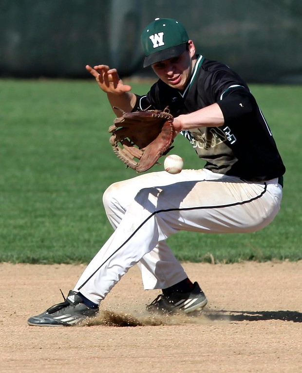 . Randy Meyers - The Morning Journal<br> Westlake shortstop Ethan Kosko makes a great backhanded stop and throws to first for the out against Lorain on April 18.